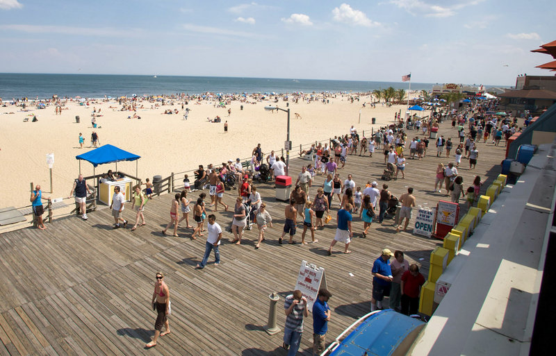 The boardwalk in Point Pleasant Beach, N.J., is one attraction that draws as many as 50,000 tourists a day to the town in the summer. Residents are pushing for earlier bar closings.