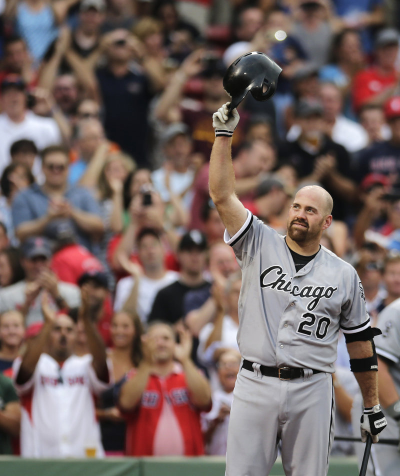 Former Boston All-Star Kevin Youkilis salutes the crowd Monday night, responding to a one-minute standing ovation he received in his return to Fenway Park as a member of the Chicago White Sox.