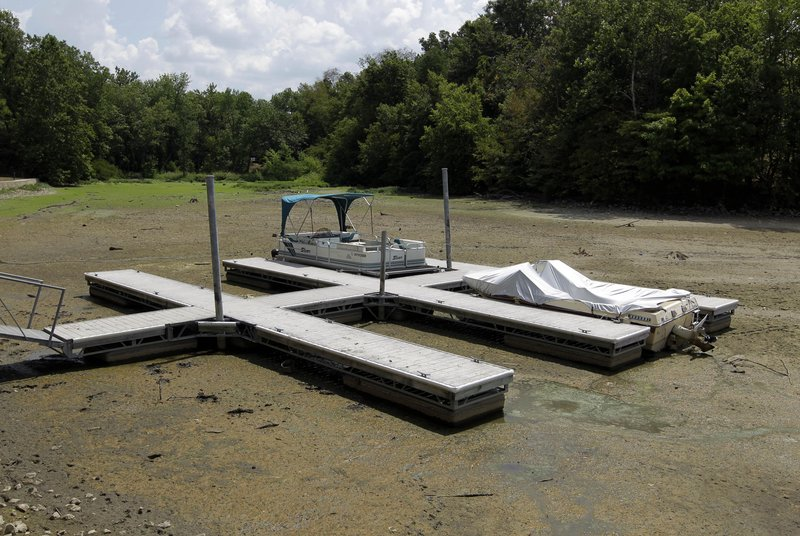 Boats sit on the bottom of a dry cove at Morse Reservoir in Noblesville, Ind., Monday. More than half the continental U.S. is now in some stage of drought.