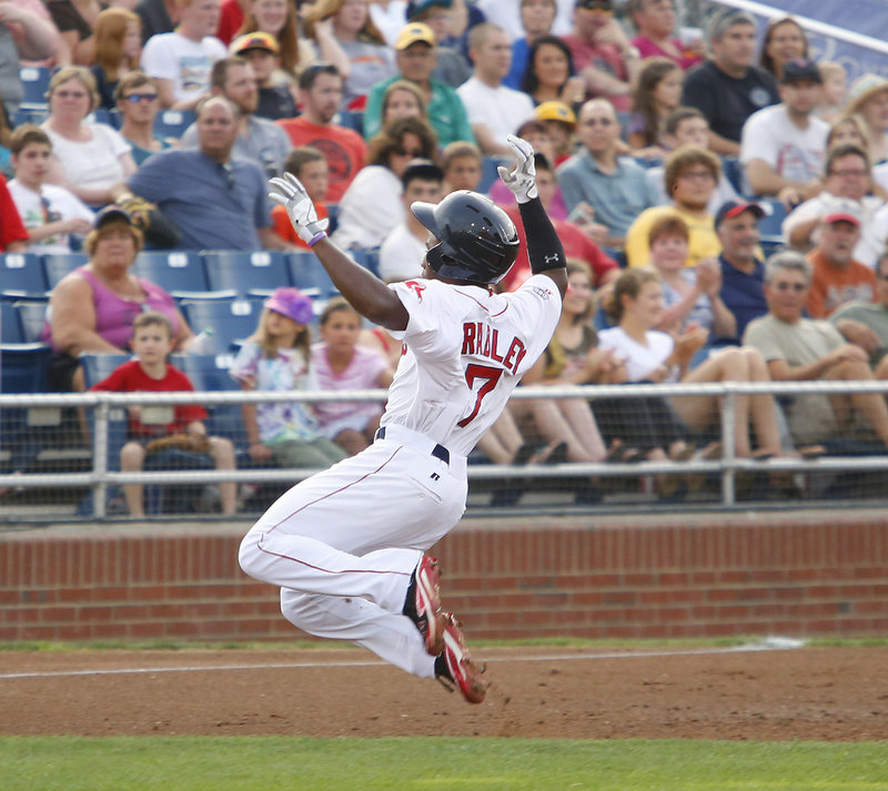 Jackie Bradley Jr. slides into third for a leadoff triple in the first inning Monday night for the Portland Sea Dogs, who were beaten 11-4 by Reading.