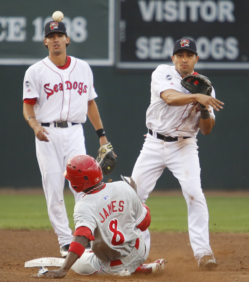 Ryan Dent of the Sea Dogs gets the forceout at second and throws to first for a double play in the third inning.
