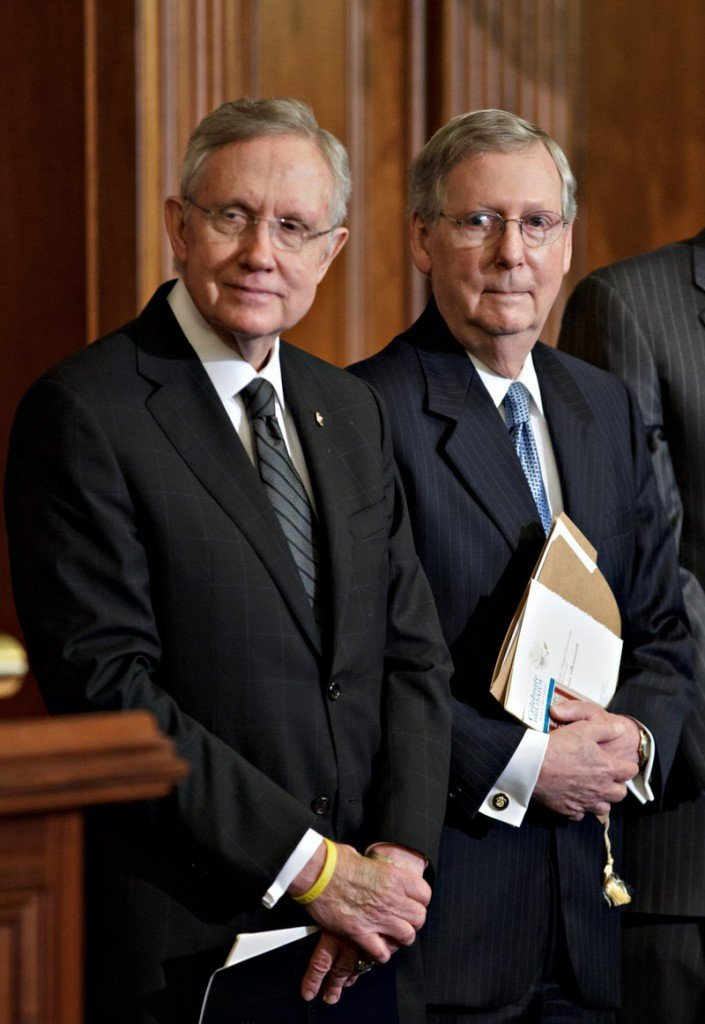 Senate Minority Leader Mitch McConnell, R-Ky., right, criticized Democrats' attempt Monday to revive the Disclose Act, while Senate Majority Leader Harry Reid, D-Nev., accused the GOP of shielding billionaire donors.