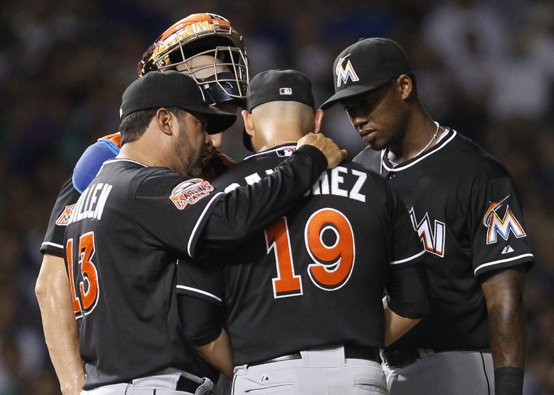 Marlins Manager Ozzie Guillen chats with pitcher Anibal Sanchez during Tuesday's game against the Cubs. Guillen was a winner in his return to Chicago.