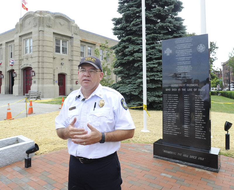 Portland Deputy Fire Chief David Jackson stands in front of the Portland Fire Department Fallen Fire Fighter Memorial at Central Fire Station on Congress Street. The memorial will be dedicated July 28.