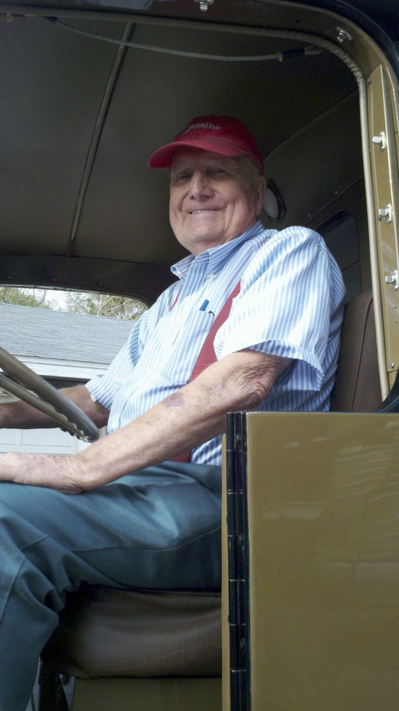 Erv Bickford is shown in 2011 in one of the trucks he restored.