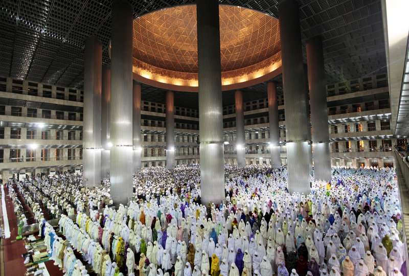 "Indonesian Muslims perform an evening prayer called ""tarawih,"" marking the first eve of the holy fasting month of Ramadan at Istiqlal Mosque in Jakarta, Indonesia, on Friday."
