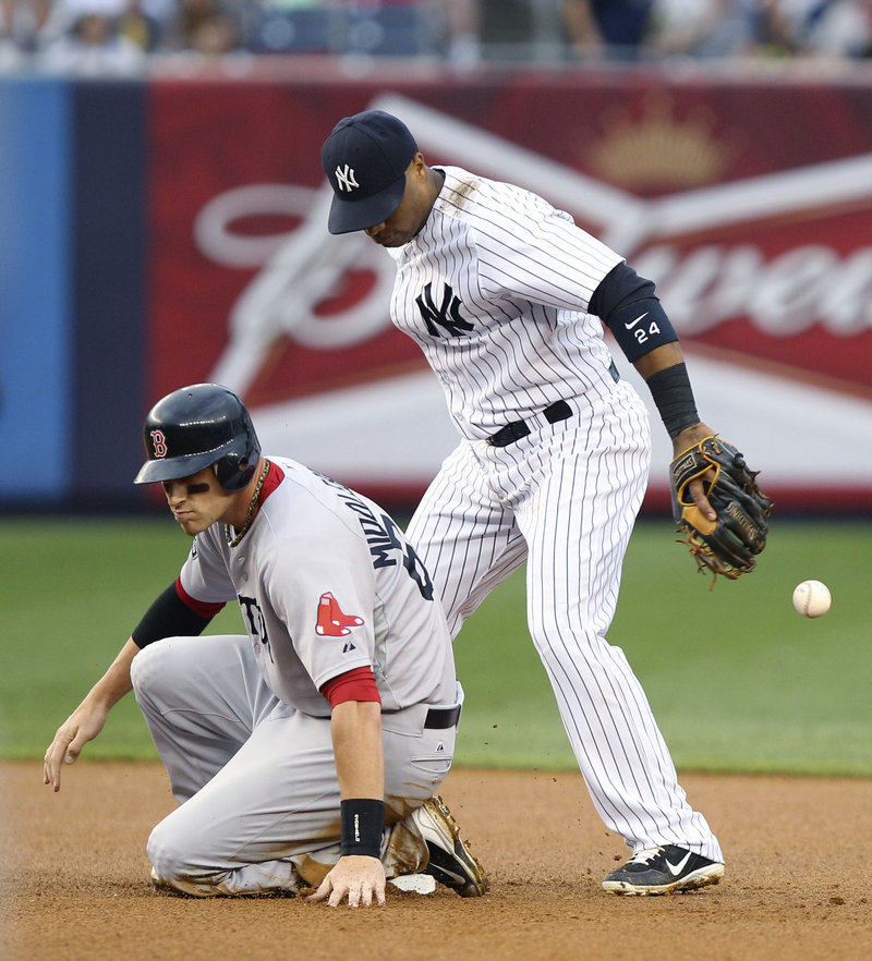 Will Middlebrooks of the Boston Red Sox is safe as second baseman Robinson Cano of the New York Yankees drops the ball Saturday. The Red Sox won, 8-6.