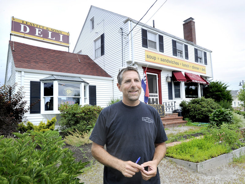 Peter Leavitt, in front of the Leavitt & Sons Falmouth location in 2014, plans to open a second deli location in Portland.