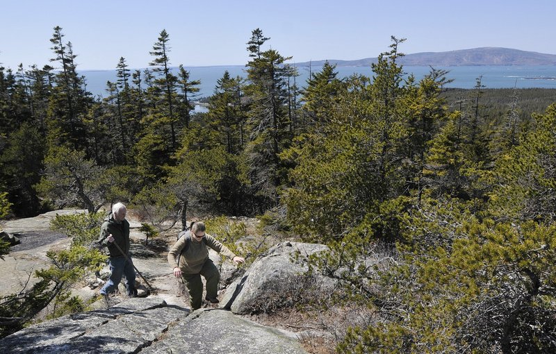 Hikers negotiate a rocky path in Acadia National Park. Despite a fatal fall at the park last week, Acadia is pretty safe compared to other parks, figures show.