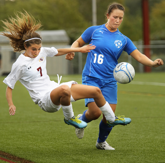 Kathryn Clark of Cape Elizabeth, left, and Bri DiPhilippo of Falmouth battle for control of the ball, Friday, Aug. 13, 2012, during the second half of their game in Cape Elizabeth.