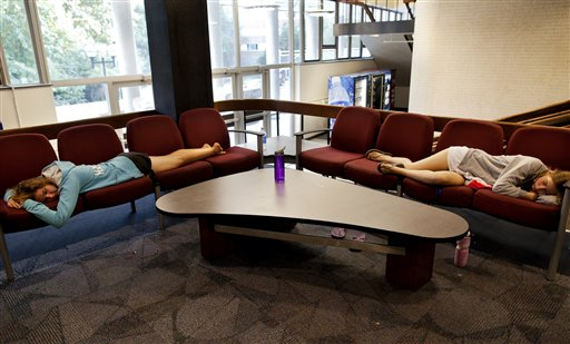 Engineering students Noelle Hansford, left, and Andrea Case take a nap in the lobby of Bursley Hall on the campus of the University of Michigan, in Ann Arbor, Mich. recently.