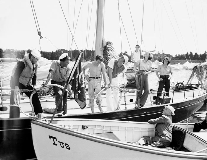 Franklin D. Roosevelt (in launch) is greeted at the schooner Benham, his son's yacht, off Campobello Island on Aug. 14, 1939. Franklin D. Roosevelt Jr. and his wife (both looking aloft) greeted the president.