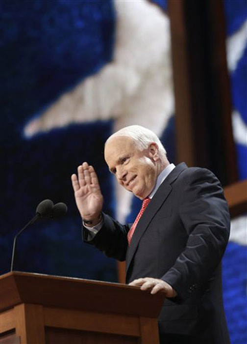 Arizona Senator John McCain gestures as he walks up to the podium during the Republican National Convention in Tampa, Fla., on Wednesday, Aug. 29, 2012. (AP Photo/Charles Dharapak)