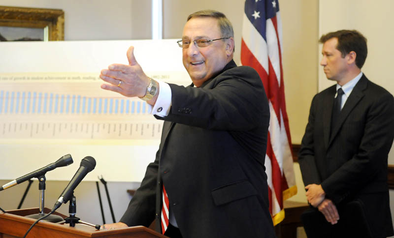 Governor Paul LePage and Commissioner of Education Stephen Bowen, right, reacted to a report by Harvard University's Program on Education Policy and Governance during a press conference last Wednesday in Augusta.