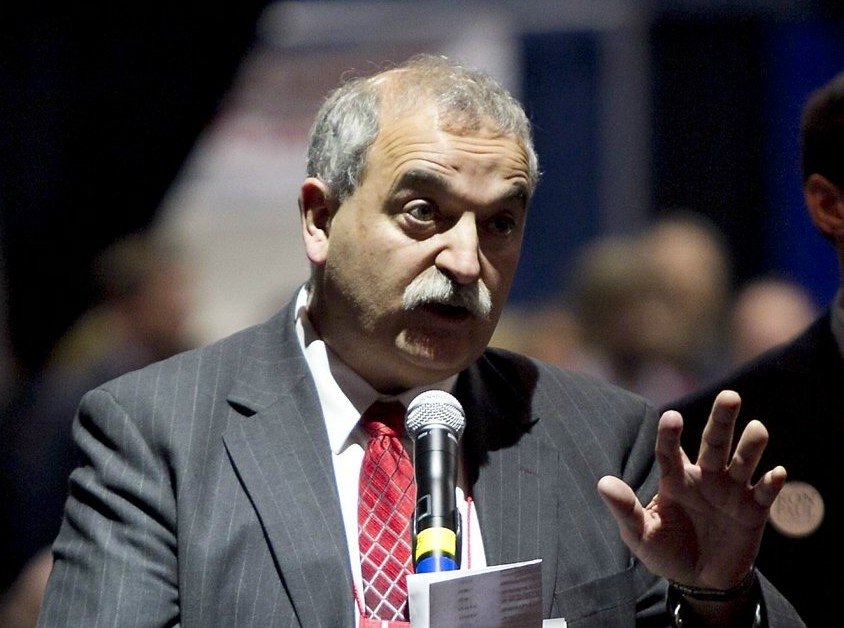 State party chairman Charlie Webster addresses the Republican Convention to urge leaders to try to wrap up business on time rather than incur additional costs for renting Augusta Civic Center in Augusta, Maine, Sunday, May 6, 2012. (AP Photo/Robert F. Bukaty)