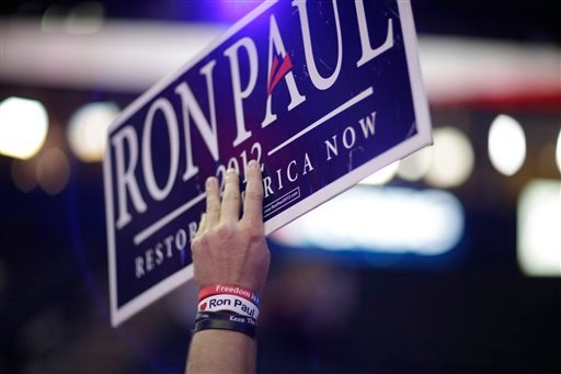 A Ron Paul supporter holds up a sign at the Republican National Convention on Monday.