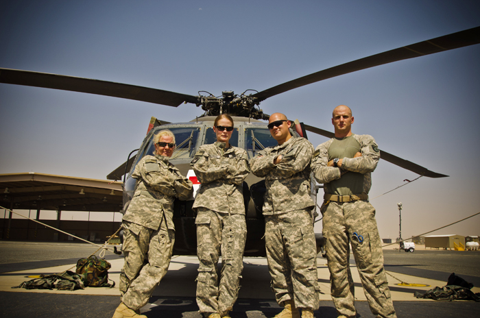 Staff Sgt. Jessica Wing is on the left in this photo of members of the126th Air Medevac Company, Maine Army National Guard, standing next to a UH-60 Blackhawk helicopter in the Middle East.