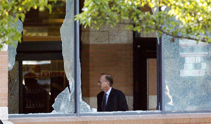Middlesex County prosecutor Bruce Kaplan is seen through two broken windows as he arrives at the scene of a shooting at a Pathmark grocery store in Old Bridge, N.J., Friday.