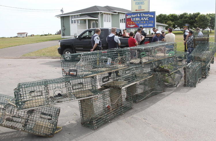 Fishermern in Cap Pele block access to Westmorland Fisheries and Cape Bald Packers on Aug. 2.