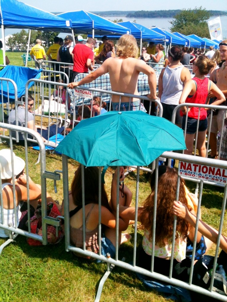 Festival-goers wait in line to get into the