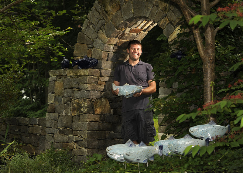 "Tyson Weiss' Falmouth yard holds some of his ceramic fish, which ""swim"" through the greenery, providing a fluid aesthetic."