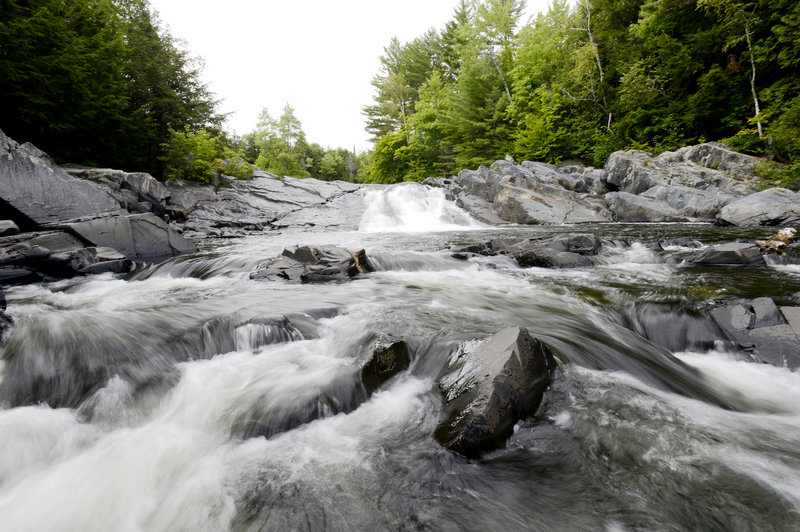 Water rushes over the rocks at Tobey's Falls in Piscataquis County. Even during this hot Maine summer and in the midst of a national drought, the region's waterfalls remain impressive.