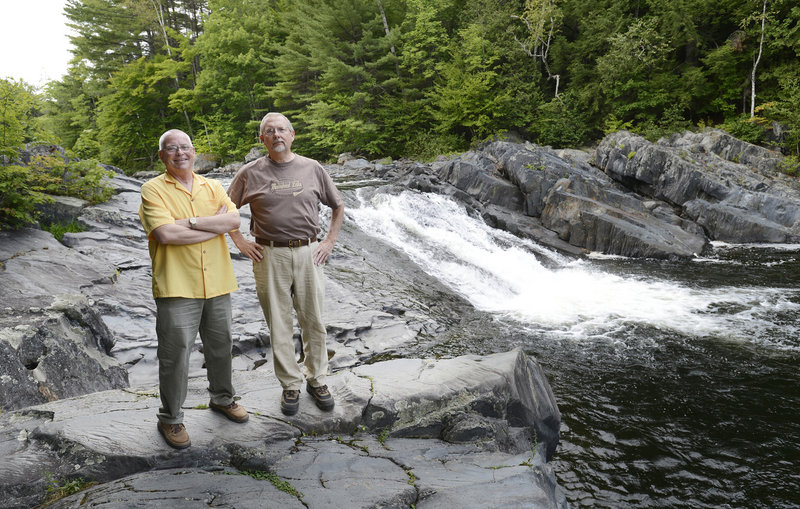 Kenneth Woodbury Jr., left, director of the Piscataquis Economic Council, and Bob Hamer, executive director of the Moosehead Lake Chamber of Commerce, show off Tobey's Falls.