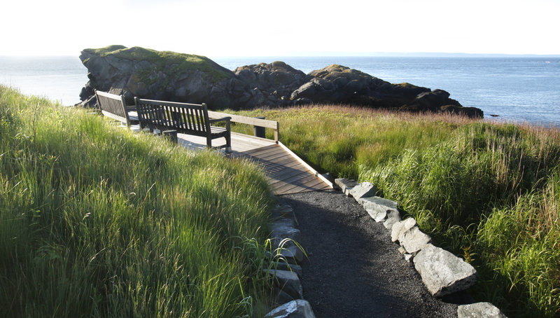 A path leads to benches overlooking Sugar Loaf Rock at Liberty Point in Roosevelt Campobello International Park. The number of visitors to the park has crept back up since 2009.