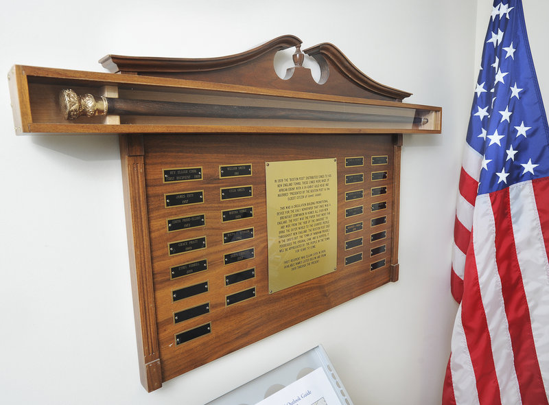 Windham's original Boston Post cane is displayed in the town office with a plaque bearing the names of recipients.