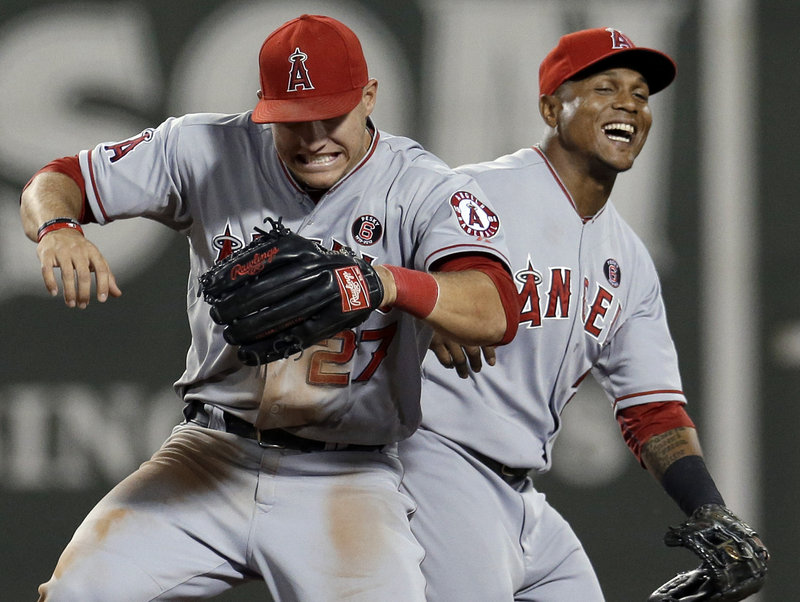 Center fielder Mike Trout, left, and shortstop Erick Aybar laugh as they celebrate a victory for the Los Angeles Angels at Fenway Park. Trout, with 139 hits, has the most for a rookie through 100 games since Tony Oliva had 144 in 1964.