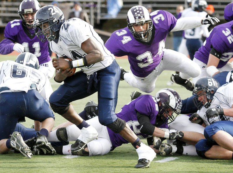 Kenny Sweet (34) of Deering is known for his defense but also figures to be a force at running back.