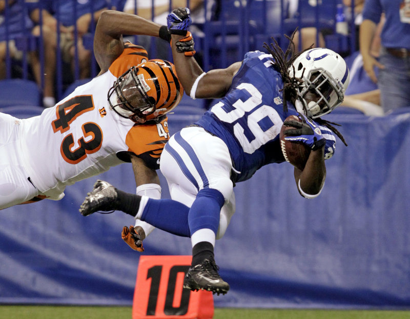 Deji Karim of the Indianapolis Colts, right, is brought down by safety George Iloka of the Cincinnati Bengals in the first half of Indianapolis' 20-16 victory in an exhibition finale Thursday night at Indianapolis.