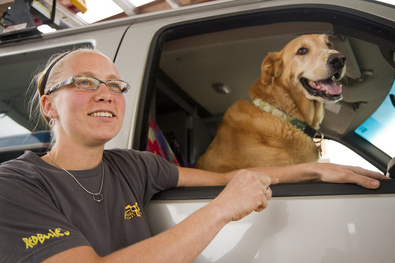 M.J. Reed of Pownal talks about the spike in gasoline prices as she and her dog stopped to fill up at a station in Portland. The average price for gas nationwide rose about 40 cents from July 1 to mid-August.