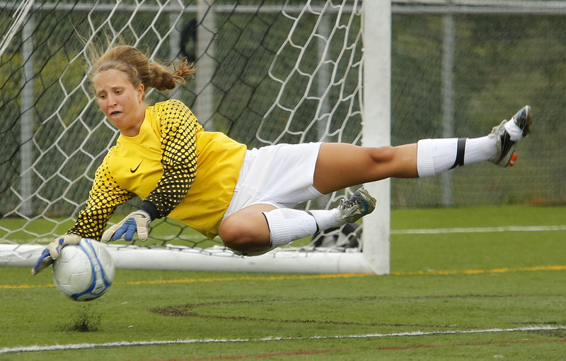 Falmouth goalie Caroline Lucas makes a diving stop – one of several key saves she made in the second half to help the Yachtsmen secure a 2-1 victory Friday in their season opener at Cape Elizabeth.