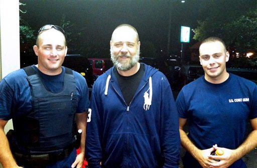 A photo provided by the U.S. Coast Guard shows Russell Crowe, center, with Coast Guard petty officers Robert Swieciki, left, and Thomas Watson Sunday Sept. 2, 2012. Crowe and a friend became disoriented while kayaking in Long Island Sound Sunday and called the Coast Guard for assistance. (AP Photo/U.S. Coast Guard)
