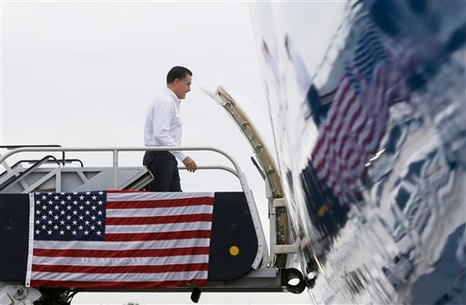 Republican presidential candidate and former Massachusetts Gov. Mitt Romney boards his campaign charter plane in West Palm Beach, Fla., Friday, Sept. 21, 2012. (AP Photo/Charles Dharapak)