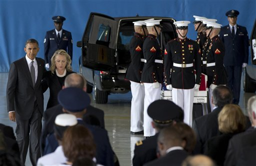 President Barack Obama and Secretary of State Hillary Rodham Clinton walk back to their seats after speaking during the Transfer of Remains Ceremony on Friday at Andrews Air Force Base, Md., marking the return to the United States of the remains of the four Americans killed this week in Benghazi, Libya.