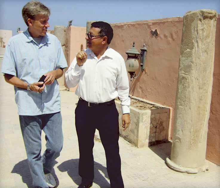 U.S. Ambassador Christopher Stevens, left, walks with an unidentified translator last month in Tripoli, Libya. Stevens served as emissary to Libyan rebels when they were fighting to oust Moammar Gadhafi.