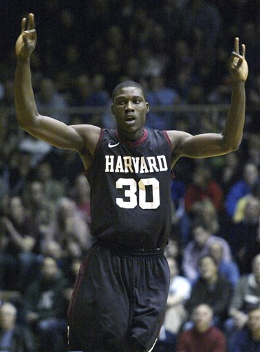 In Feb. 10, 2012, file photo, Harvard's Kyle Casey (30) celebrates after he scored against Penn in the first half of an NCAA college basketball game in Philadelphia. Casey plans to withdraw from school amid a cheating scandal that also may involve other athletes, according to several reports. Sports Illustrated and the Harvard Crimson reported Tuesday that Casey, a senior, would withdraw in an attempt to preserve a year of eligibility once the issue is resolved. (AP Photo/H. Rumph Jr, File)