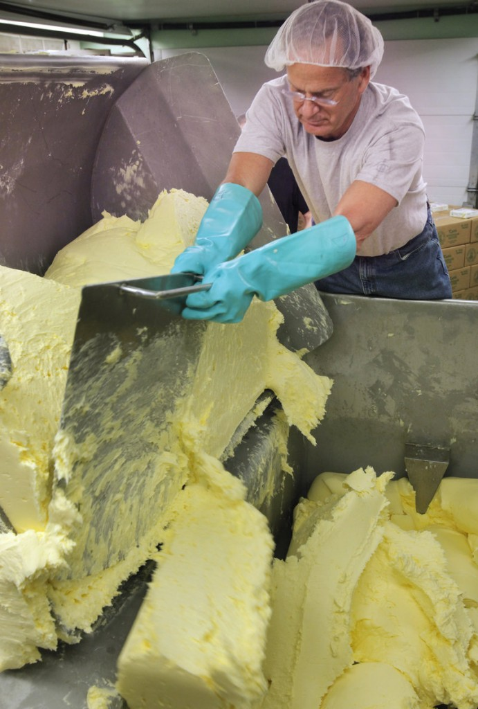 Dan Patry carves off chunks of butter into a vat at Kate's Homemade Butter in Old Orchard Beach on Tuesday, April 12, 2011. Patry started the company in 1981 with his wife.