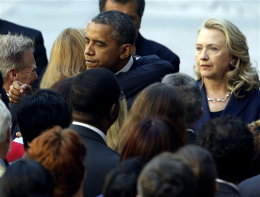 President Barack Obama, accompanied by Secretary of State Hillary Rodham Clinton, meets with State Department personnel in the courtyard of the State Department in Washington on Wednesday after speaking at the White House concerning the recent deaths of Americans in Libya.
