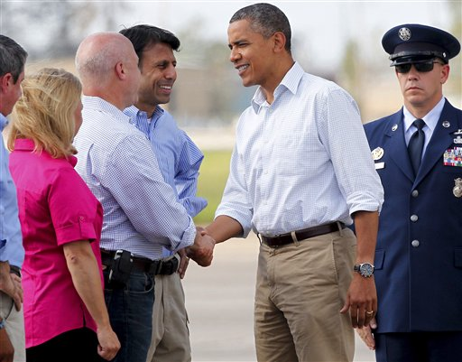 President Barack Obama greets New Orleans Mayor Mitch Landrieu, as Louisiana Gov. Bobby Jindal, center, and Sen. Mary Landrieu, D-La., watch in Kenner, La., on Monday.