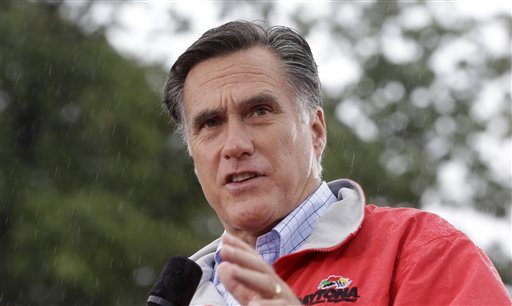 In this Sept. 14, 2012, photo, Republican presidential candidate, former Massachusetts Gov. Mitt Romney campaigns in the rain at Lake Erie College in Painesville, Ohio. (AP Photo/Charles Dharapak)