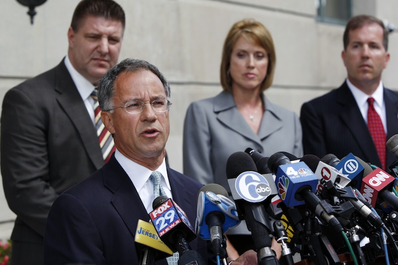 U.S. Attorney Paul Fishman, second left, stands with other law enforcement officials outside the Federal courthouse Monday, Sept. 10, 2012, in Trenton, N.J., as he announces that Federal agents arrested Trenton Mayor Tony Mack, the mayor of New Jersey's capital city, earlier Monday as part of an ongoing corruption investigation into bribery allegations related to a parking garage project that was concocted as part of an FBI sting operation. Mack, his brother, Ralphiel, and convicted sex offender Joseph Giorgianni, a Mack supporter who owns a Trenton sandwich shop, were accused of conspiring to obstruct, delay and affect interstate commerce by extortion under color of official right. (AP Photo/Mel Evans)