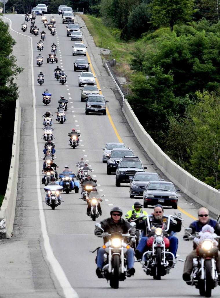 Hundreds of motorcyclists joined others on I-95 in Waterville on Sunday for the 31st annual United Bikers of Maine Toy Run, which provides toys for Maine children during the holiday season.