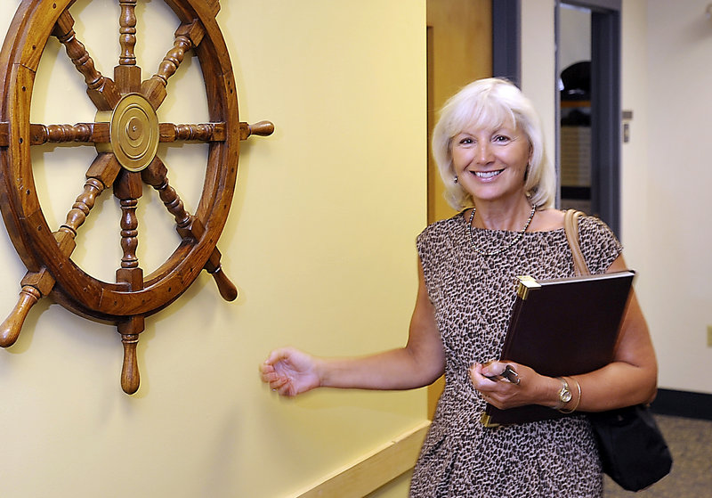 Falmouth Superintendent Barbara Powers and other educators are helping the state develop a better system to gauge a school's adequate yearly progress.