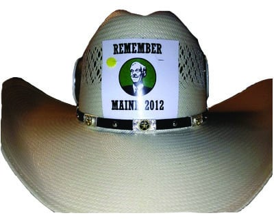 Members of Texas' Republican National Convention delegation sympathetic to Maine's Ron Paul supporters made these stickers, as seen here on a Texan's cowboy hat.