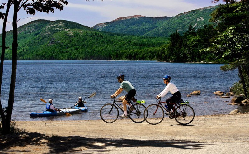 Visitors enjoy Eagle Lake at Acadia National Park, which saw a 17.6 percent jump in visits in May and a nearly 4 percent jump in June compared with a year earlier, then a dip in July.