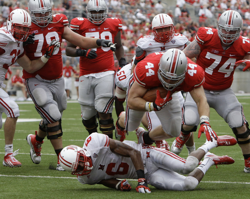 Zach Boren of Ohio State dives over D.J. Brown to score a touchdown during the Buckeyes' 56-10 win Saturday over Miami (Ohio).