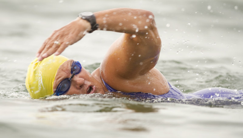 Open-water swimmer Pat Gallant-Charette of Westbrook trains at Pine Point Beach in Scarborough on Friday.